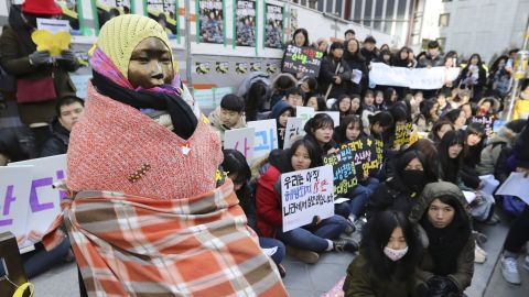 """Students gather near a """"comfort woman"""" statue during a rally in front of the Japanese Embassy in Seoul, South Korea for a weekly """"Wednesday demonstration"""" on January 11, 2017."""