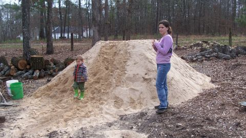 Broookings' daughter Hope with her brother Roman in the early stages of building the house