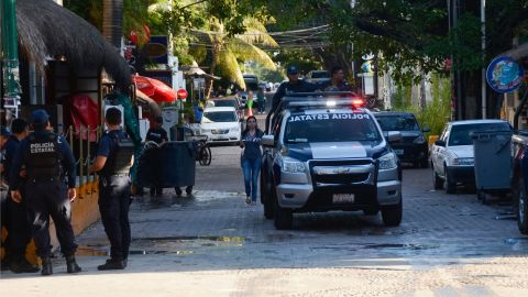 Mexican police agents patrol near a nightclub in Playa del Carmen, Quintana Ro state, Mexico where 5 people were killed, three of them foreigners, during a music festival on January 16, 2017.A shooting erupted at an electronic music festival in the Mexican resort of Playa del Carmen early Monday, leaving at least five people dead and sparking a stampede, the mayor said. Fifteen people were injured, some in the stampede, after at least one shooter opened fire before dawn at the Blue Parrot nightclub during the BPM festival. / AFP PHOTO / STRSTR/AFP/Getty Images