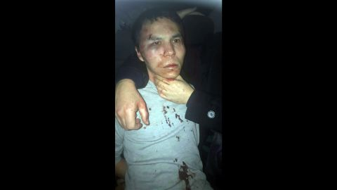 """This handout picture released by the Turkish police and taken from Dogan News Agency on January 16, 2017 shows the main suspect in the Reina nightclub rampage captured by Turkish police after a gunman killed 39 people, including many foreigners, in an attack at an upmarket nightclub in Istanbul where revellers were celebrating the New Year. Turkish police late on January 16, 2017 caught the attacker who shot dead 39 people on New Year's night at an Istanbul nightclub, state-run TRT television reported. The alleged attacker was found along with his four-year-old son in an apartment in the Esenyurt district of Istanbul after a massive police operation, TRT reported.  / AFP PHOTO / DOGAN NEWS AGENCY / Handout /  - Turkey OUT / RESTRICTED TO EDITORIAL USE - MANDATORY CREDIT """"AFP PHOTO / DOGAN NEWS AGENCY / TURKISH POLICE"""" - NO MARKETING NO ADVERTISING CAMPAIGNS - DISTRIBUTED AS A SERVICE TO CLIENTSHANDOUT/AFP/Getty Image"""