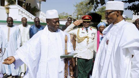 Jammeh, left, meets with Nigerian President Muhammadu Buhari on Friday in Gambia's captial, Banjul.