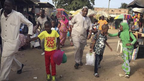 Facing uncertainty, people in Banjul head to a ferry Tuesday destined for Senegal.