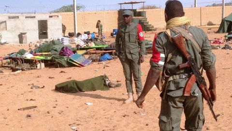 A soldier's body is covered after a suicide bombing at a military camp in northern Mali on Wednesday.
