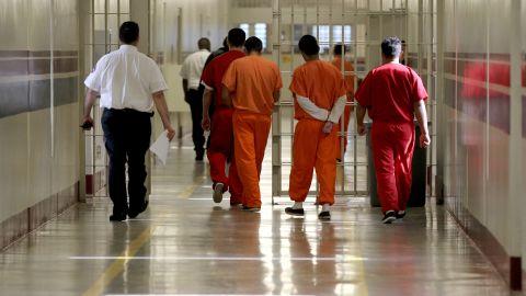 Detainees at the Stewart Detention Center in Lumpkin, Georgia, are escorted through a corridor.