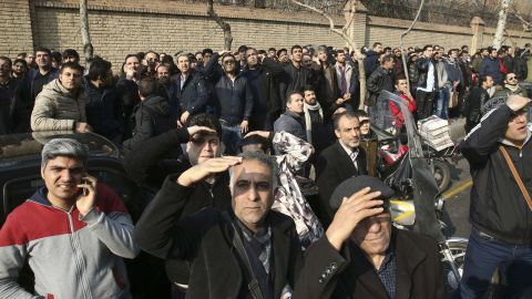 Iranians watch as firefighters work to extinguish the blazing Plasco building.