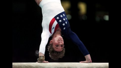 Kerri Strug vaults during the women's team gymnastics competition in the Georgia Dome at the Summer Olympic Games in Atlanta on July 23, 1996. Strug injured her left ankle following this routine but completed her second vault to clinch the team gold medal for the US women.