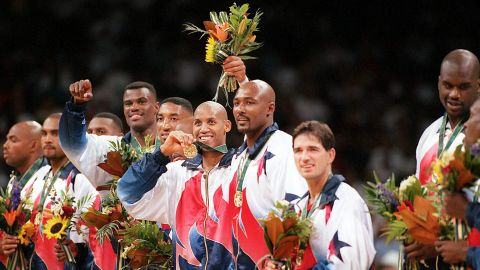 Dream Team member Reggie Miller, center, flashes his gold medal as he stands surrounded by other members of Team USA during the medal presentation in Atlanta's Georgia Dome at the 1996 Summer Olympics. Standing, from left to right, are Charles Barkley, Grant Hill, Penny Hardaway, David Robinson, Scottie Pippen, Miller, Karl Malone, John Stockton and Shaquille O'Neal.