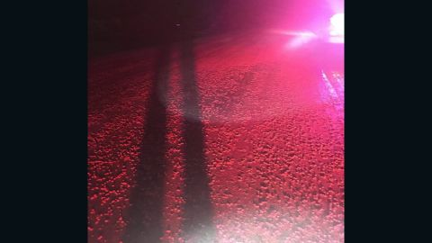 Spilled red Skittles litter the road in rural Wisconsin.