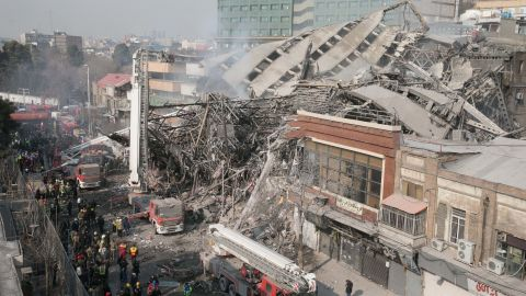 The rubble of the Plasco building in Tehran, Iran, is seen after it collapsed following a fire on Thursday, January 19. As many as 30 firefighters are feared dead, according to Iran's semi-official Fars news agency. Official news agency IRNA cited the head of Tehran Emergency Services as saying 70 people were injured in the fire.
