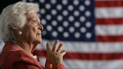 """<a href=""""https://www.cnn.com/2018/04/17/politics/barbara-bush-dies/index.html"""">Former first lady Barbara Bush</a>, the matriarch of a Republican political dynasty and a first lady who elevated the cause of literacy, died April 17, 2018, at age 92. Here, she listens as her son, President George W. Bush, addresses an event in Orlando in 2005. She was the second woman in US history to have had a husband and a son elected President. Her husband, George H.W. Bush, was the 41st President of the United States. Her son was the 43rd."""