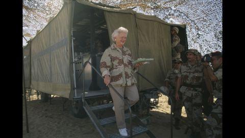 Barbara Bush celebrates Thanksgiving with US Marines in Saudi Arabia during the Gulf War.