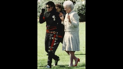 Pop star Michael Jackson walks with the first lady near the White House Rose Garden.