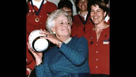 Bush prepares to throw a rugby ball after receiving it from Mary Sullivan -- captain of the US women's rugby team -- on February 7, 1992. The US team, which won the World Cup, received the Team Spirit Award from Bush.