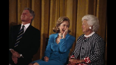 Bush sits beside Bill Clinton and his wife, Hillary. Bill Clinton, the 42nd President of the United States, defeated George H.W. Bush in the 1992 presidential election.