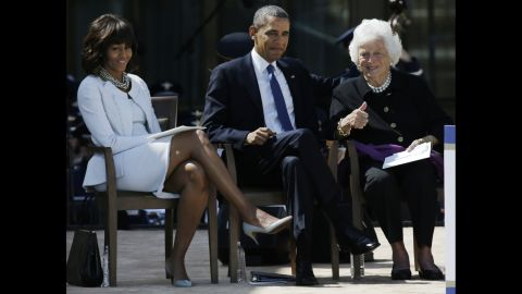 The former first lady gives the thumbs-up to guests during a dedication of the George W. Bush Presidential Center on April 25, 2013. She is seated next to US President Barack Obama and first lady Michelle Obama.