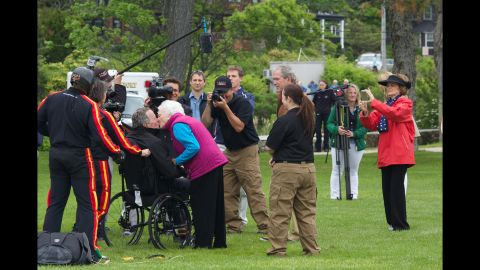 The former first lady kisses her husband after he went skydiving in Kennebunkport, Maine, on June 12, 2014. The former President was celebrating his 90th birthday.