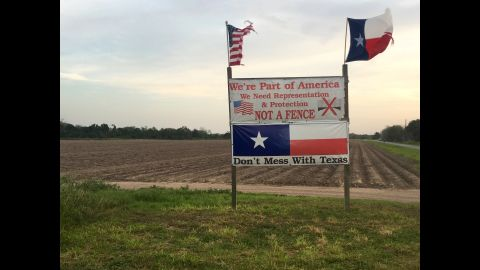 """Taylor put this sign up down the road from her house during the 2016 presidential election.  She says that the fence the US government put up near her property in 2007 doesn't work. """"I would like for Mr. Trump, I would even feed him, if he will come down here and talk to the people,"""" Taylor told CNN. """"He is doing exactly what the government did to us in the beginning. He's not asking how it's going to affect the people that live here."""""""