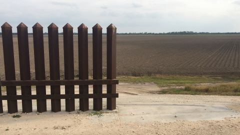 """On October, 26, 2006, President George W. Bush signed the Secure Fence Act, and said, """"This bill I'm about to sign is an important step in our nation's efforts to secure our border and reform our immigration system."""" More than 1,250 miles of the border are in Texas, but the state only has about 100 miles of man-made borders. This fence line in Progreso Lakes, Texas, comes to an end, and leaves miles of border land open."""