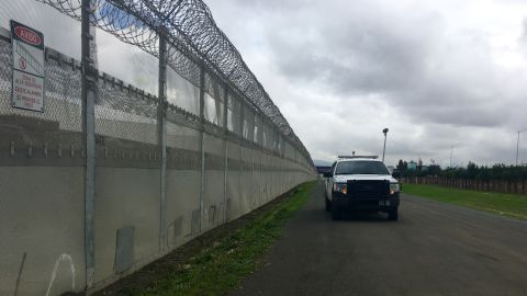 A US Customs and Border Protection officer patrols the fence in Otay Mesa, California. Patched holes in the fence are a common sight along this section of the border next to Tijuana, Mexico.