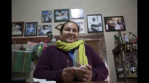 """Lilia Falcon owns Jose Falcon's restaurant in Boquillas del Carmen, Mexico, across the Rio Grande from Big Bend National Park in Texas. The border crossing closed after September 11, 2001, and reopened in April 2013. """"This town just went dead,"""" Falcon told CNN. """"We are very happy that the border is reopened again. We feel very safe here, even tourists that come over here, the word is spreading out more that its very safe to come here."""""""