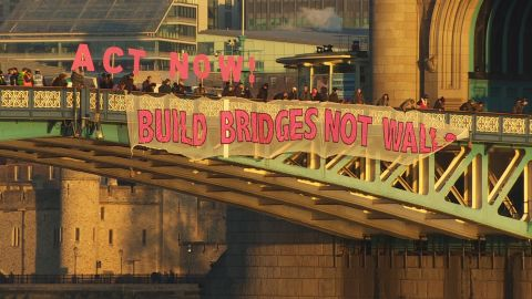 """A """"Bridges Not Walls"""" banner hangs from London's Tower Bridge on Friday."""