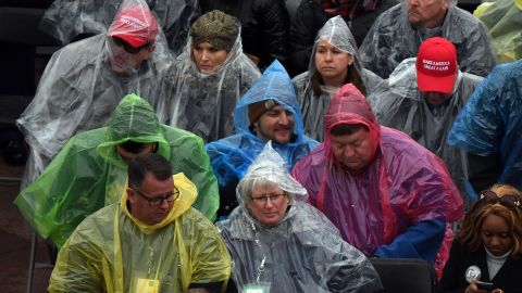 The rain doesn't deter a crowd from gathering to watch the inauguration ceremony.