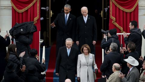 Obama and Vice President Joe Biden arrive on the West Front of the Capitol. Senate Minority Leader Chuck Schumer and House Minority Leader Nancy Pelosi step before them.