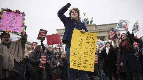 Protesters rally in front of the Brandenburg Gate in Berlin.