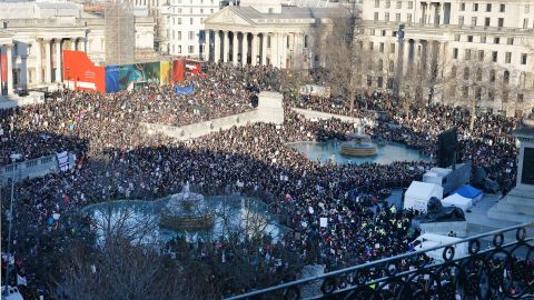 Protesters listen to speeches in London's Trafalgar Square after taking part in a march to promote women's rights.