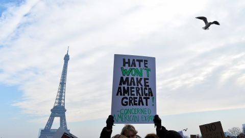 Protesters hold up anti-Trump signs as more than 2,000 people protest during the Women's March on the Trocadero in front of the Eiffel Tower in Paris, France on January 21, 2017.