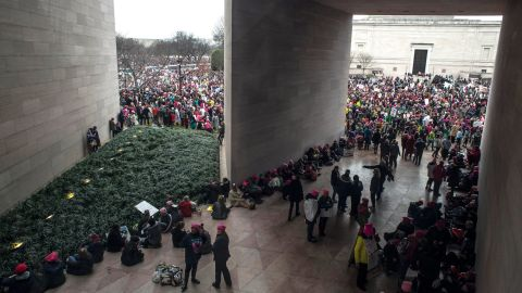 Demonstrators take a break from marching at the National Gallery of Art.