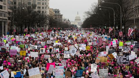 """A large crowd walks down Pennsylvania Avenue after the start of the Women's March on Washington on Saturday, January 21, 2017. Organizers said the march is sending a message to Donald Trump that """"women's rights are human rights."""" Similar protests unfolded across the country."""