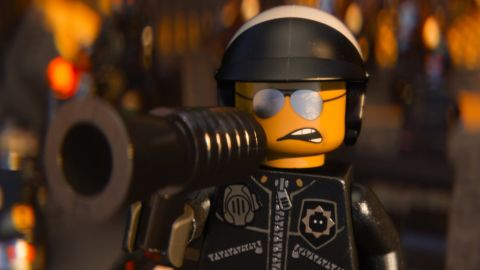 """Liam Neeson voices both Good Cop and Bad Cop, whose head swivels around to reveal two faces, in """"The Lego Movie."""""""