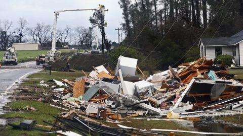 Power workers make repairs near Barney, Georgia, on January 22.