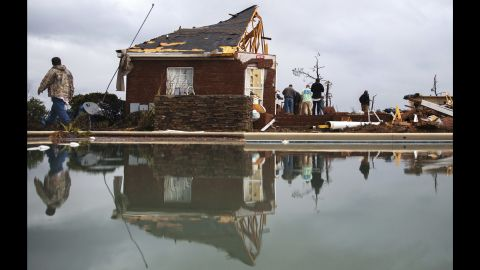 A swimming pool reflects people cleaning up in Adel on January 22.