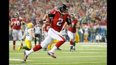 Falcons quarterback Matt Ryan runs for a 14-yard touchdown in the second quarter.