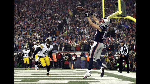 Patriots wide receiver Chris Hogan scores during the first half.
