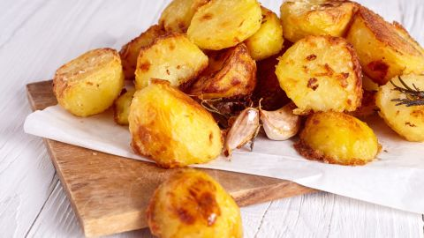 """Starchy foods, such as bread and potatoes, can produce high levels of the compound acrylamide if cooked at high temperatures and for too long. This compound is what makes these foods golden in color. If overly cooked, they become brown, or black, resulting in excess levels of acrylamide and <a href=""""https://www.ncbi.nlm.nih.gov/pmc/articles/PMC4164905/"""" target=""""_blank"""" target=""""_blank"""">previous studies in mice</a> have linked acrylamide to cancer risk."""