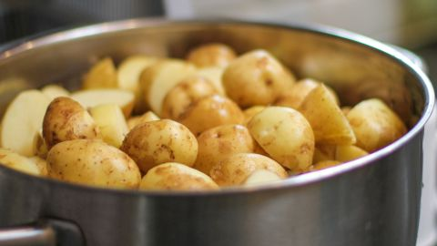Boiled potatoes do not produce acrylamide as temperatures do not reach more than 100 degrees when boiling water. This is why they remain white in color.