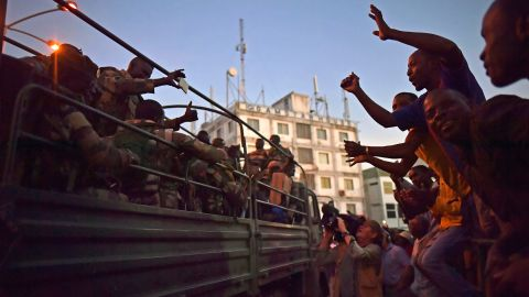 Citizens celebrate the arrival of  troops after the former President Yahya Jammeh fled the country.