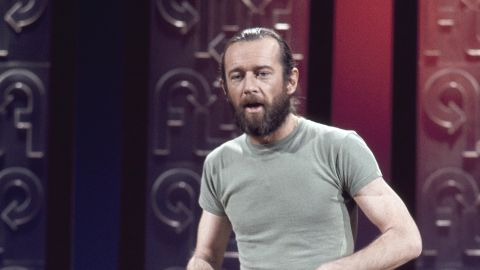 """George Carlin went from performing as a mild-mannered stand-up comic to a shaggy-haired, bearded social critic who also happened to be damn funny. It was Carlin, of course, who gave us the """"seven dirty words you can never say on television,"""" and whose obscenity-filled comedy prompted the Supreme Court to allow broadcasters to censor offensive material."""