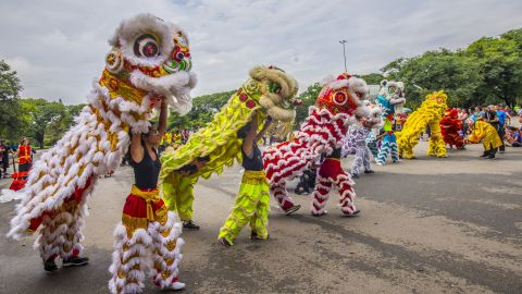 People wear costumes during a parade in Sao Paulo, Brazil, on Sunday, January 22.