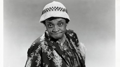 """Moms Mabley was known to black audiences for decades before she was """"discovered"""" by mainstream audiences in the 1960s, and through it all the quality and cleverness of her comedy never changed. Relying on a grandmotherly persona, Mabley -- credited as <a href=""""https://mobile.nytimes.com/2010/01/03/arts/03carroll.html"""" target=""""_blank"""" target=""""_blank"""">the first female stand-up comedian</a> -- could be as raunchy as her younger, male counterparts, but with a slyness that proved her comic genius."""
