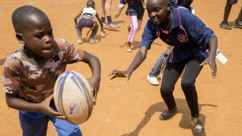 It was introduced by volunteer worker Emma Rees, who was traveling with a rugby ball.