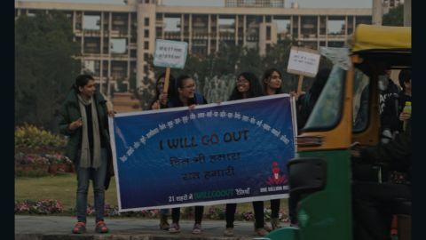 Yashashvini Jodha and Arushi Malik (center) protest in the northern Indian city of Jaipur, Rajasthan.