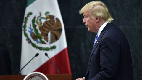US presidential candidate Donald Trump leaves after a joint press conference with Mexican President Enrique Pena Nieto (out of frame) in Mexico City on August 31, 2016. Donald Trump was expected in Mexico Wednesday to meet its president, in a move aimed at showing that despite the Republican White House hopeful's hardline opposition to illegal immigration he is no close-minded xenophobe. Trump stunned the political establishment when he announced late Tuesday that he was making the surprise trip south of the border to meet with President Enrique Pena Nieto, a sharp Trump critic.  / AFP / YURI CORTEZ        (Photo credit should read YURI CORTEZ/AFP/Getty Images)