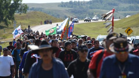Protestors march to a construction site for the Dakota Access Pipeline to express their opposition to the pipeline, at an encampment where hundreds of people have gathered to join the Standing Rock Sioux Tribe's to protest against the construction of the new oil pipeline, near Cannon Ball, North Dakota, on September 3, 2016. The Indian reservation in North Dakota is the site of the largest gathering of Native Americans in more than 100 years. Indigenous people from across the US are living in camps on the Standing Rock reservation as they protest the construction of the new oil pipeline which they fear will destroy their water supply.  / AFP / Robyn BECK        (Photo credit should read ROBYN BECK/AFP/Getty Images)