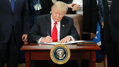 President Donald Trump signs an executive order for border security and immigration enforcement improvements, Wednesday, Jan. 25, 2017, at the Homeland Security Department in Washington.  (AP Photo/Pablo Martinez Monsivais)