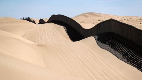 IMPERIAL SAND DUNES, CA - SEPTEMBER 28:  The U.S.-Mexico border fence snakes over sand dunes on September 28, 2016 in the Imperial Sand Dunes recreation center, California. Without daily removal of sand, which drifts against the fence, the dunes would cover the fence and undocumented immigrants and smugglers could simply walk over it. The border stretches almost 2,000 miles between Mexico and the United States. Border security and immigration issues have become major issues in the U.S. Presidential campaign.  (Photo by John Moore/Getty Images)