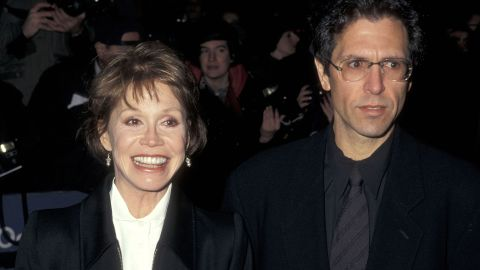 """Moore and her third husband, Robert Levine, attend the New York premiere of """"The English Patient"""" in 1996. She was married to Levine when she died."""